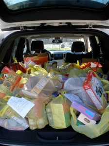 Collecting food for the local food pantries during the holiday seasons.